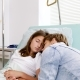 Mother Sleeping in Hospital Bed Next To Her Sick Daughter - VideoHive Item for Sale