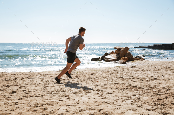 Healthy young sportsman jogging - Stock Photo - Images