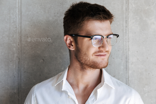 Close up portrait of a smiling young man in eyeglsses - Stock Photo - Images