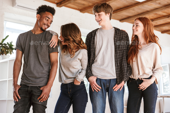 Cheerful friends students laughing. - Stock Photo - Images