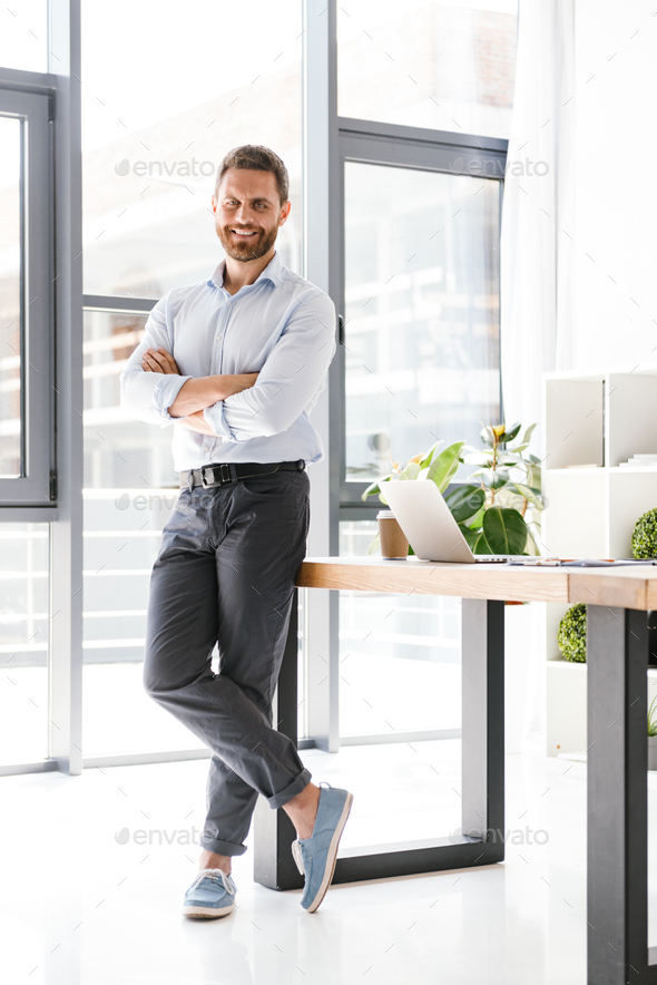 Cheerful happy bearded man in office - Stock Photo - Images