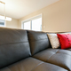 Leather sofa seating closeup with pillows - PhotoDune Item for Sale