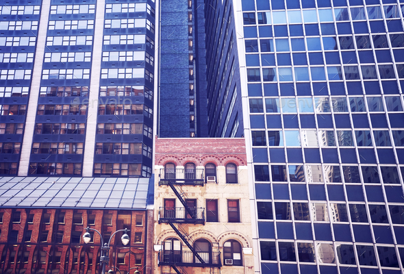 Old building between modern skyscrapers in New York City. - Stock Photo - Images