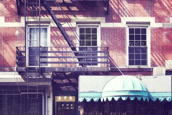 Building facade with fire escape, New York City. - Stock Photo - Images