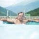 Young Man Sunbathe and Relax on a Sunny Day in a Luxurious Pool on a Background - VideoHive Item for Sale