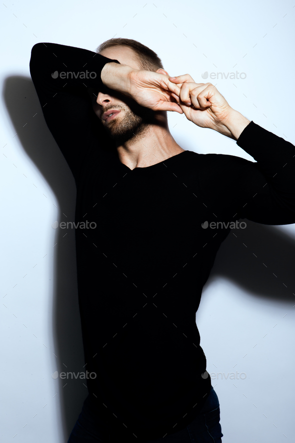 Young muscular bearded man wearing black tshirt - Stock Photo - Images