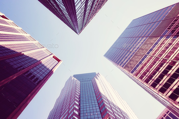Looking up at Manhattan skyscrapers at sunset. - Stock Photo - Images