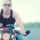 Large Portrait of a Biker on a Motorcycle - VideoHive Item for Sale