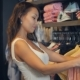 Beatiful Girl Choosing a T-shirt in the Shop - VideoHive Item for Sale