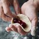 Woman cook manually sculpts dumplings stuffed with cherries - PhotoDune Item for Sale