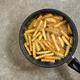 frying potatoes in a pan - PhotoDune Item for Sale