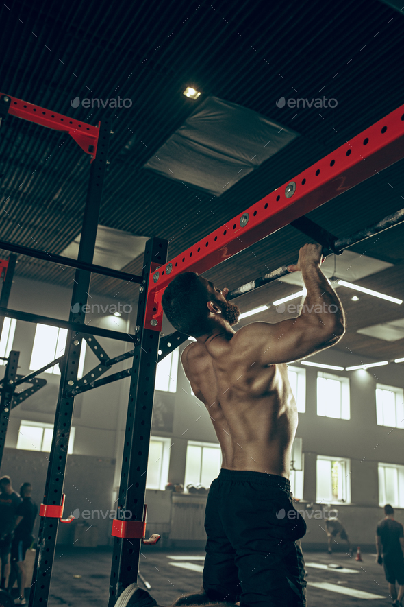 Concept: power, strength, healthy lifestyle, sport. Powerful attractive muscular man at CrossFit gym - Stock Photo - Images