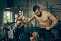 Man and woman during exercises in the fitness gym. CrossFit. - PhotoDune Item for Sale