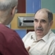 Doctor Talking To Senior Male Patient at Office - VideoHive Item for Sale