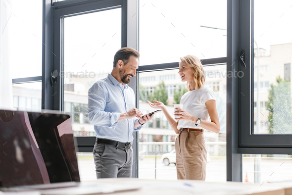 Couple of excited colleagues - Stock Photo - Images