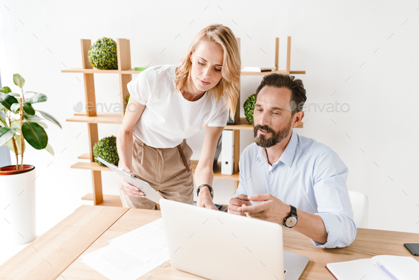Couple of concentrated colleagues - Stock Photo - Images