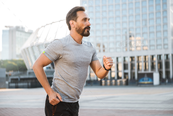 Handsome strong mature sportsman running - Stock Photo - Images