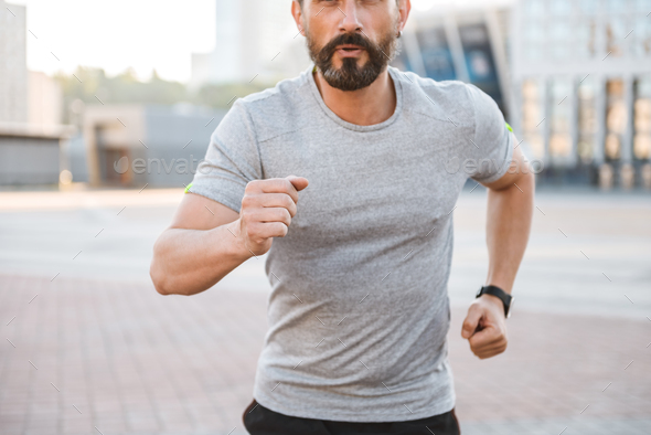 Cropped photo of handsome strong mature sportsman - Stock Photo - Images