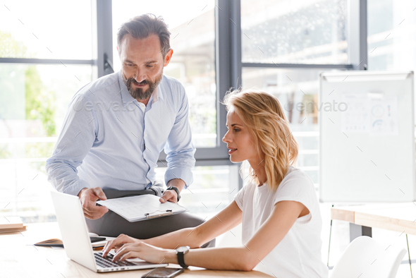 Couple of colleagues discussing work - Stock Photo - Images