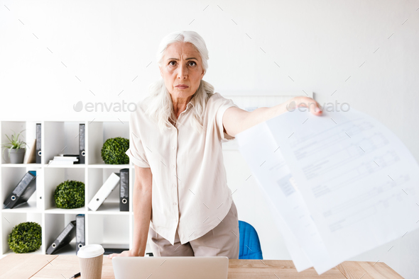 Angry mature business woman - Stock Photo - Images