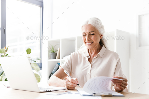 Mature happy cheerful woman indoors - Stock Photo - Images