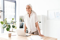 Happy mature business woman leaning on desk - PhotoDune Item for Sale