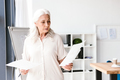 Confident mature business woman analyzing documents - PhotoDune Item for Sale