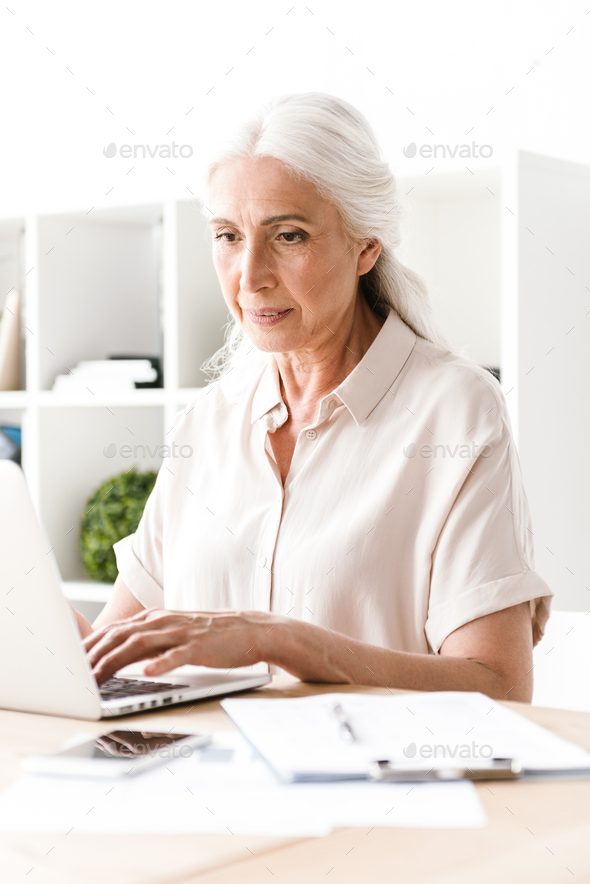 Confident mature business woman - Stock Photo - Images
