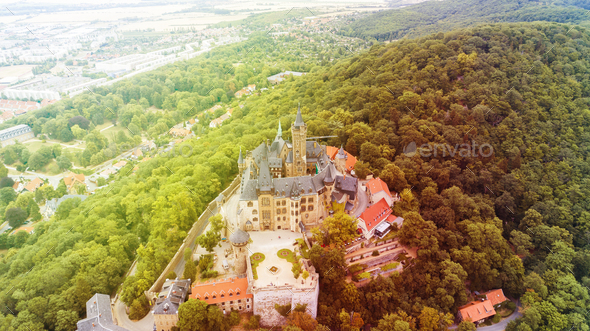 Aerial top view of medieval castle on the top of the mountain - Stock Photo - Images