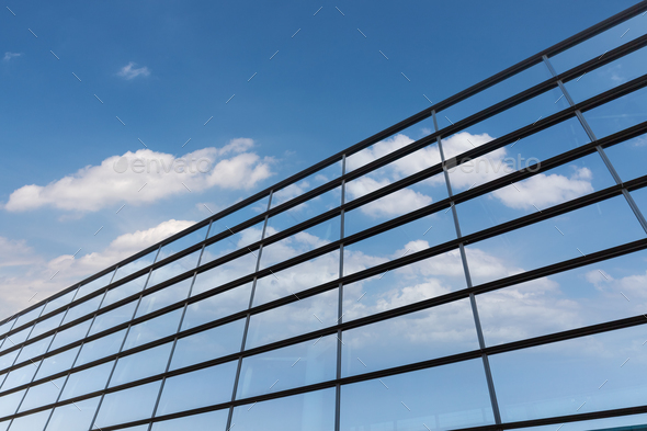 blue sky was reflected in the glass curtain wall - Stock Photo - Images