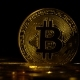 Scattered Bitcoins on the Surface Revolve on a Black Background. - VideoHive Item for Sale