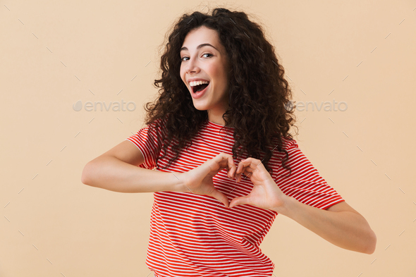 Happy young woman make heart love gesture. - Stock Photo - Images