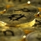 Bitcoin Coins Spin in a Circle and Shimmer. - VideoHive Item for Sale