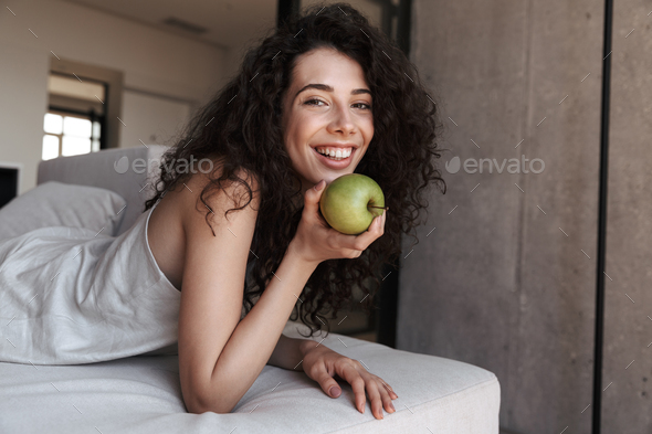 Photo of gorgeous curly woman 20s with long dark hair wearing si - Stock Photo - Images