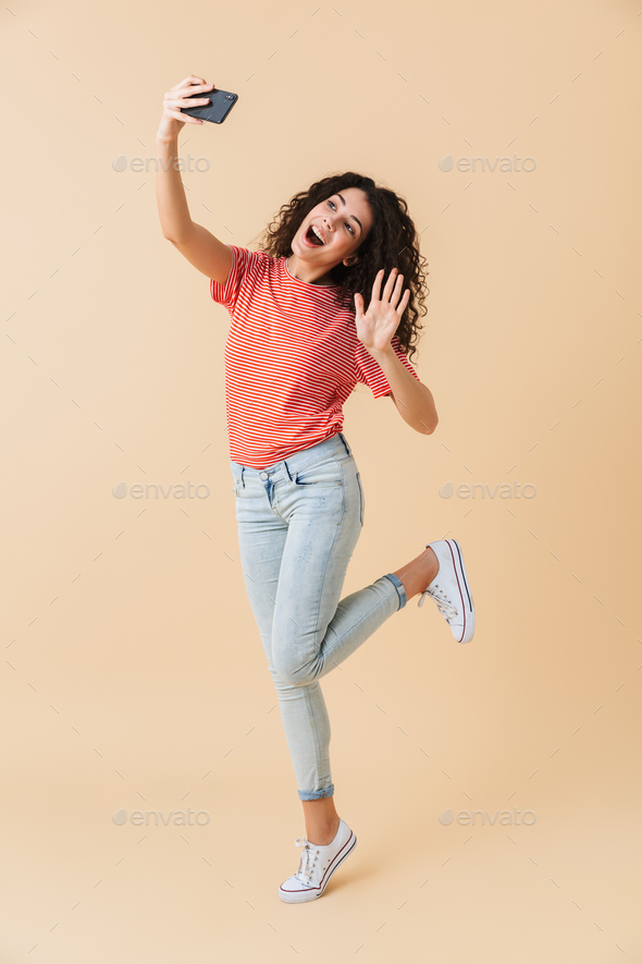 Full length portrait of a joyful young girl - Stock Photo - Images
