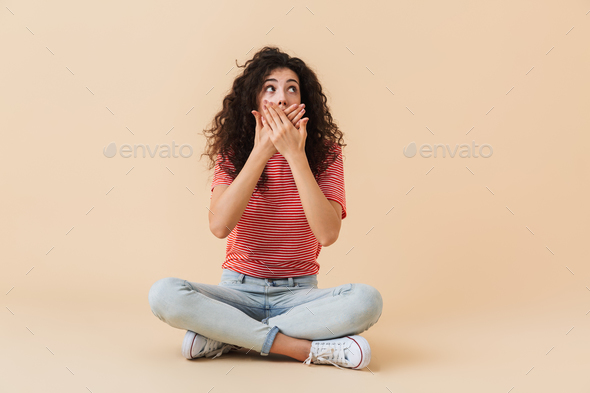 Excited shocked young woman looking aside. - Stock Photo - Images