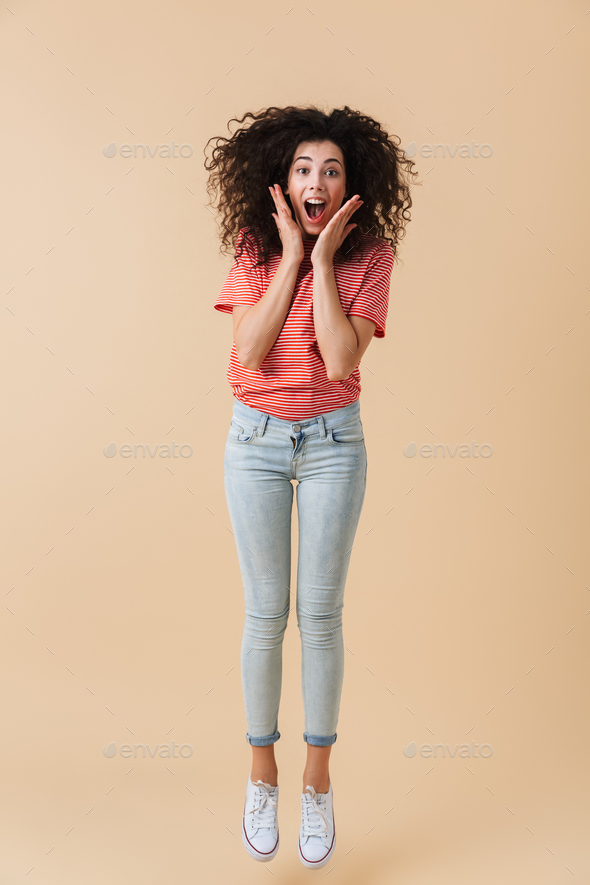 Full length portrait of a joyful young woman - Stock Photo - Images