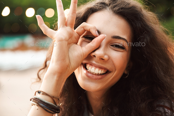 Photo of vivacious teen woman 18-20 smiling and looking at you t - Stock Photo - Images