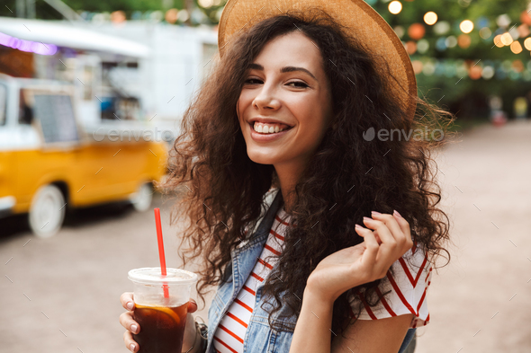 Image of joyful pretty woman 18-20 with curly brown hair wearing - Stock Photo - Images