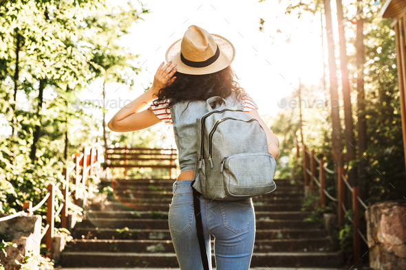Photo from back of attractive woman 18-20 wearing summer clothes - Stock Photo - Images