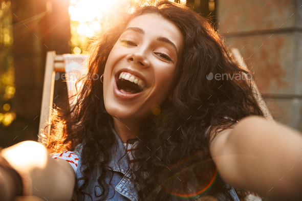 Happy young beautiful curly woman - Stock Photo - Images