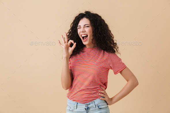 Happy emotional young woman showing okay gesture. - Stock Photo - Images