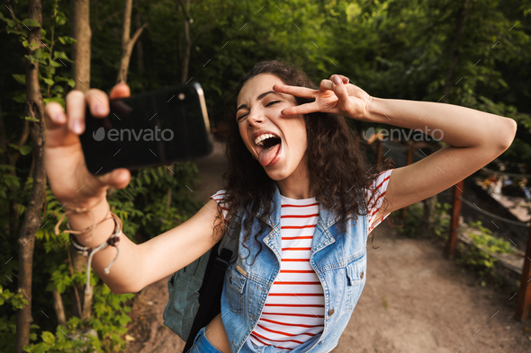Photo of brunette crazy girl 18-20 wearing casual clothes, showi - Stock Photo - Images