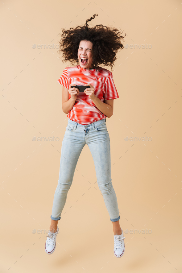 Full length portrait of a happy young girl - Stock Photo - Images