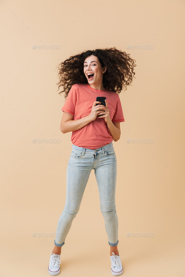 Full length portrait of a cheerful casual girl - Stock Photo - Images