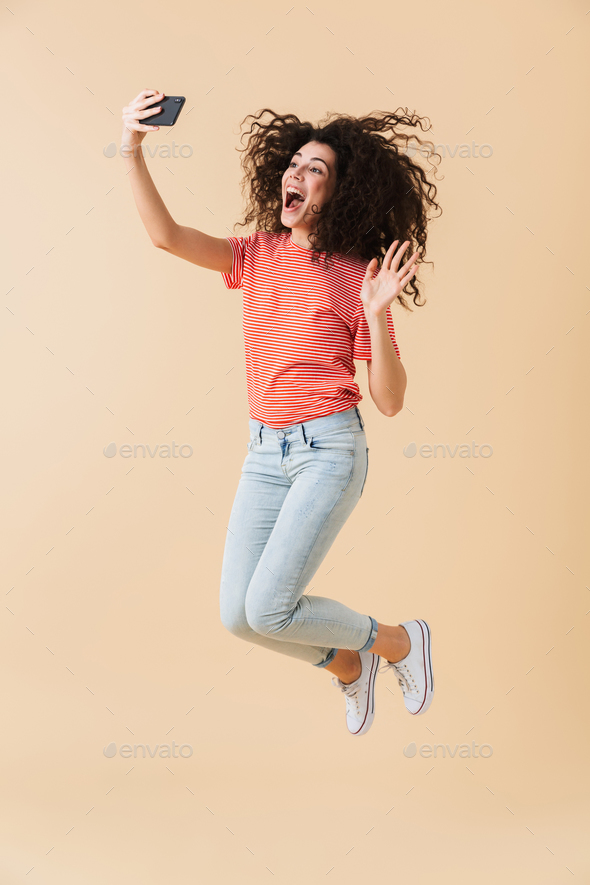 Full length portrait of a cheerful young girl - Stock Photo - Images