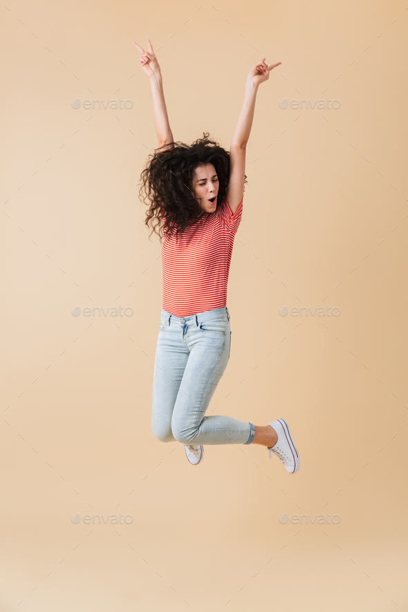 Full length portrait of a happy young woman - Stock Photo - Images
