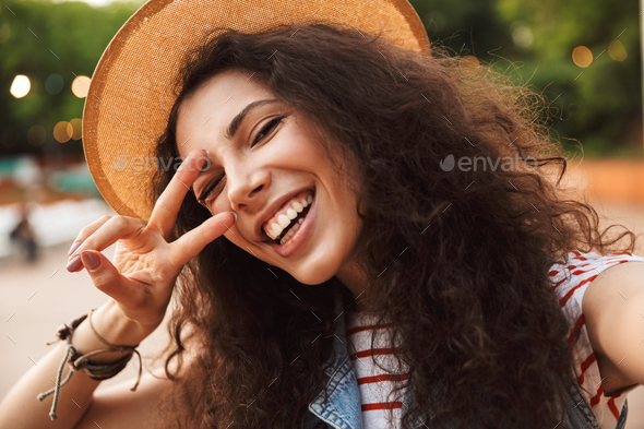 Photo closeup of attractive teenage woman 18-20 wearing straw ha - Stock Photo - Images