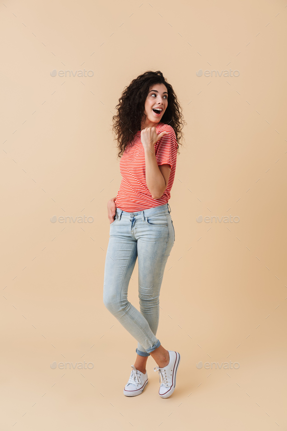 Full length portrait of a cheerful young woman - Stock Photo - Images