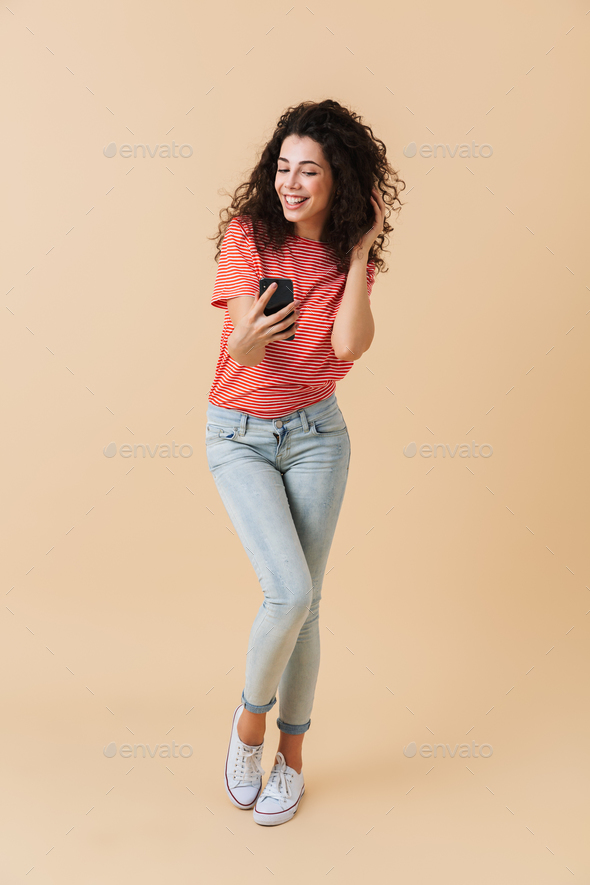 Full length portrait of a happy girl taking a selfie - Stock Photo - Images